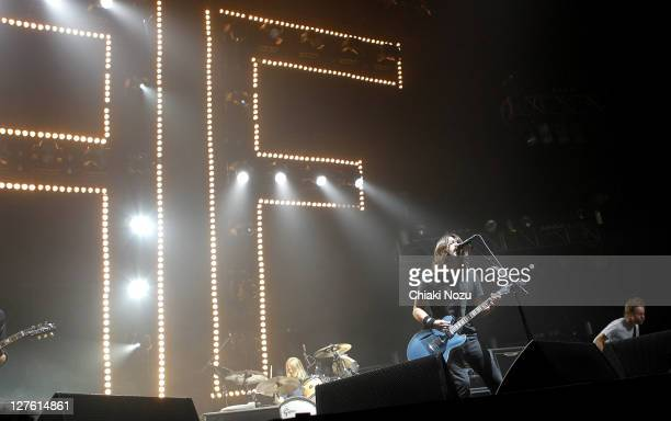 Taylor Hawkins Dave Grohl and Nate Mendel of Foo Fighters perform as part of the NME Big Gig at Wembley Arena on February 25 2011 in London England