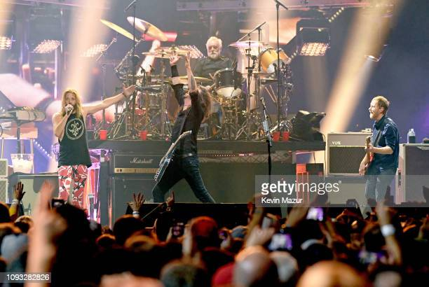 Taylor Hawkins Dave Grohl Roger Taylor and Nate Mendel perform onstage at DIRECTV Super Saturday Night 2019 at Atlantic Station on February 2 2019 in...