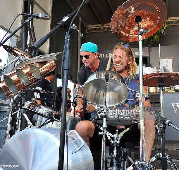 Taylor Hawkins of Foo Fighters and Chad Smith of Red Hot Chili Peppers perform on a drum kit made of culinary cookware on Day 3 of the 4th Annual...