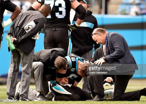 Taylor Heinicke of the Carolina Panthers injures his elbow against the Atlanta Falcons in the second quarter during their game at Bank of America...