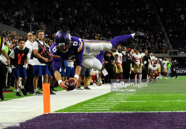 Taylor Heinicke of the Minnesota Vikings dives to complete a two-point conversion against the San Francisco 49ers to win the preseason game on August...