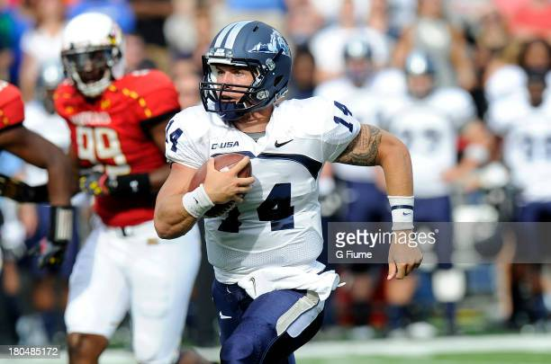Taylor Heinicke of the Old Dominion Monarchs runs the ball against the Maryland Terrapins at Byrd Stadium on September 7 2013 in College Park Maryland