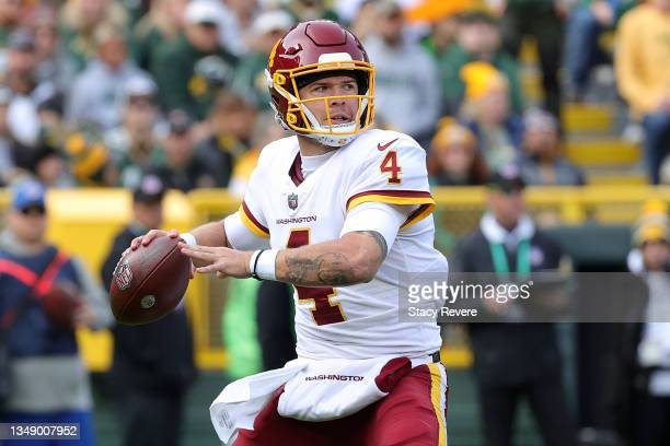 Taylor Heinicke of the Washington Football Team looks to pass during a game against the Green Bay Packers at Lambeau Field on October 24, 2021 in...