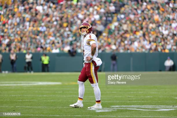 Taylor Heinicke of the Washington Football Team looks to the scoreboard during a game against the Green Bay Packers at Lambeau Field on October 24,...