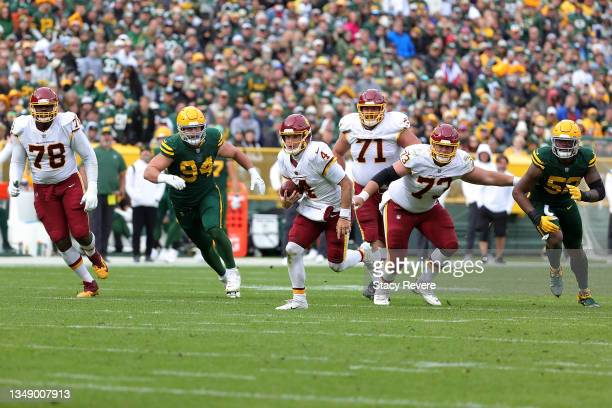 Taylor Heinicke of the Washington Football Team runs for yards during a game against the Green Bay Packers at Lambeau Field on October 24, 2021 in...
