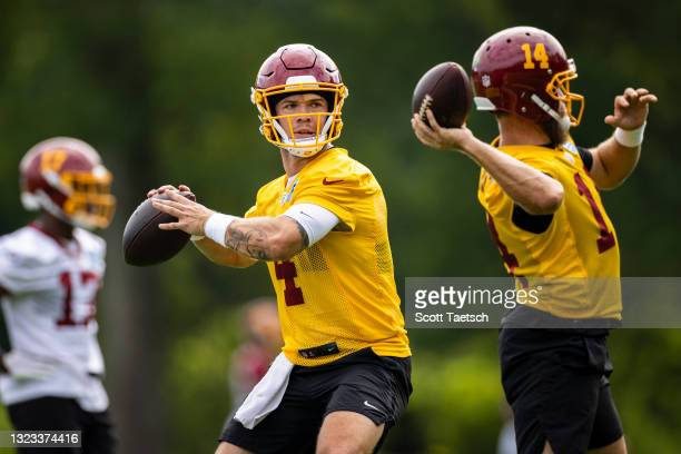 Taylor Heinicke, Ryan Fitzpatrick, and Terry McLaurin of the Washington Football Team participate in a drill during mandatory minicamp at Inova...
