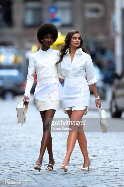 Taylor Hill and a model friend are seen at a photoshoot in Tribeca on October 11, 2019 in New York City.