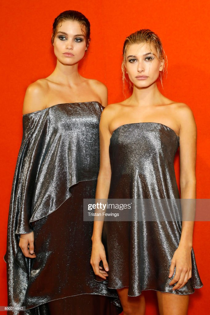Taylor Hill (L) and Hailey Baldwin are seen backstage ahead of the Alberta Ferretti show during Milan Fashion Week Spring/Summer 2018on September 20, 2017 in Milan, Italy.