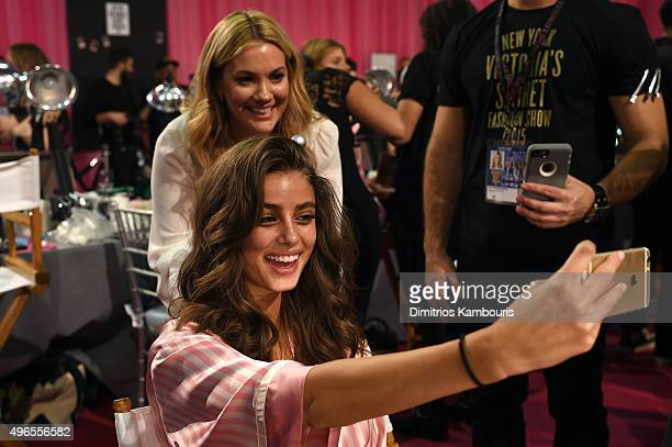 Taylor Hill and hairstylist Sarah Potempa are seen backstage before the 2015 Victoria's Secret Fashion Show at Lexington Avenue Armory on November 10...