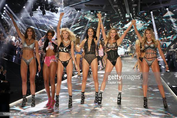 Taylor Hill Jasmine Tookes Elsa Hosk Adriana Lima Behati Prinsloo and Candice Swanepoel pose during the finale of the 2018 Victoria's Secret Fashion...