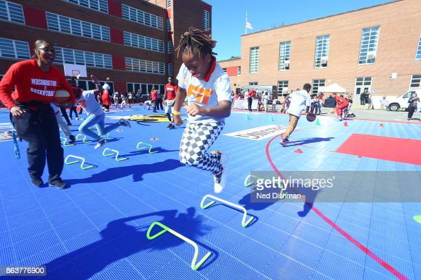 Taylor Hill of the Washington Mystics participates in a clinic at Hendley Elementary school during a court dedication and WNBA Fit Clinic on October...