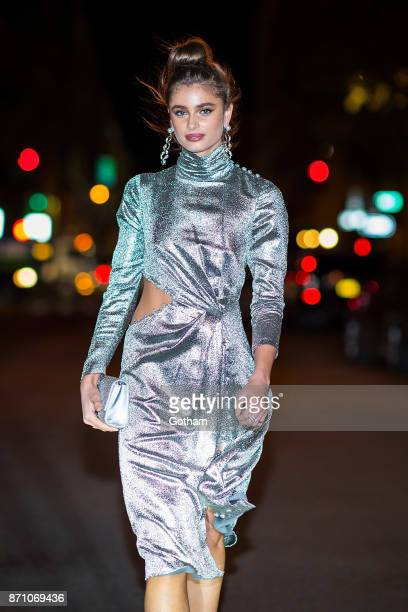 Taylor Hill seen wearing a Prabal Gurung dress with Tasaki x Prabal Gurung jewelry and Prabal Gurung shoes in Tribeca on November 6 2017 in New York...