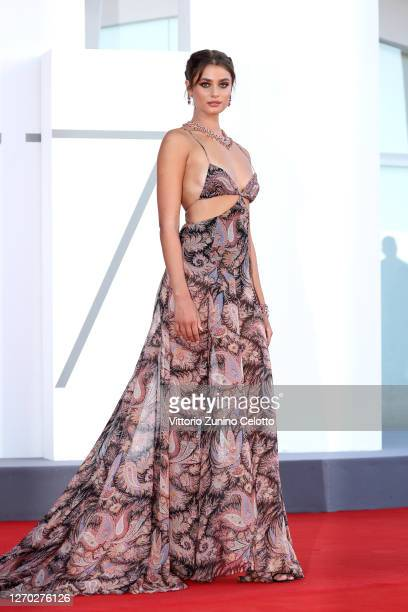 """Taylor Hill walks the red carpet ahead of the Opening Ceremony and the """"Lacci"""" red carpet during the 77th Venice Film Festival at on September 02,..."""
