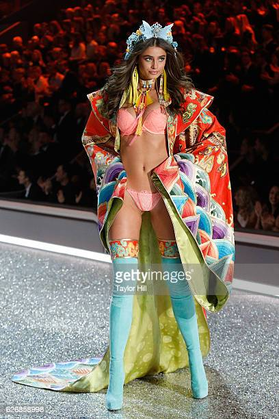 Taylor Hill walks the runway during the 2016 Victoria's Secret Fashion Show at Le Grand Palais on November 30 2016 in Paris France