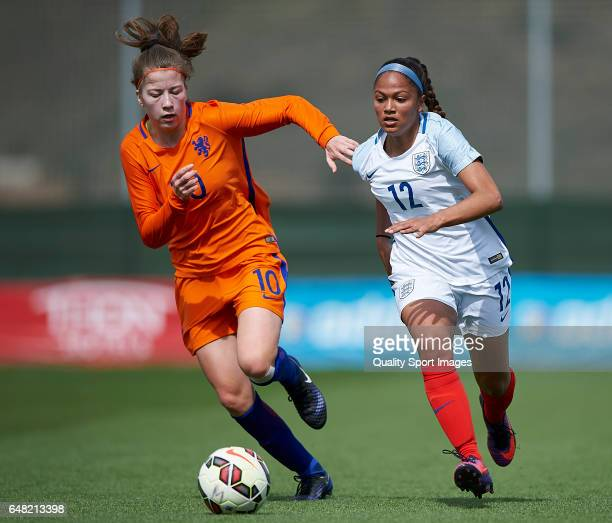 Taylor Hinds of England competes for the ball with Nurija van Schoonhoven of Netherlands during the international friendly match between England...