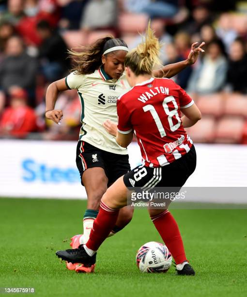 Taylor Hinds of Liverpool Women competing with Sophie Walton of Sheffield United Women during the Barclays FA Women's Championship match between...