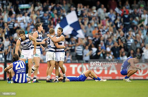 Taylor Hunt and Corey Enright of the Cats hug after the final siren during the round two AFL match between the Geelong Cats and the North Melbourne...