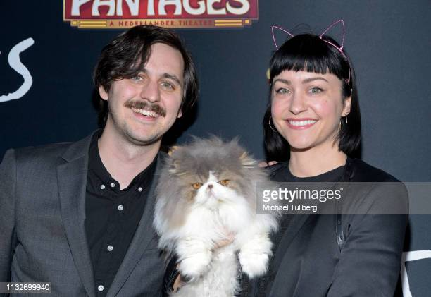 Taylor Inouye celebrity cat Dewey the Persian and Kelly Heintz attend the Los Angeles opening night performance of Cats at the Pantages Theatre on...