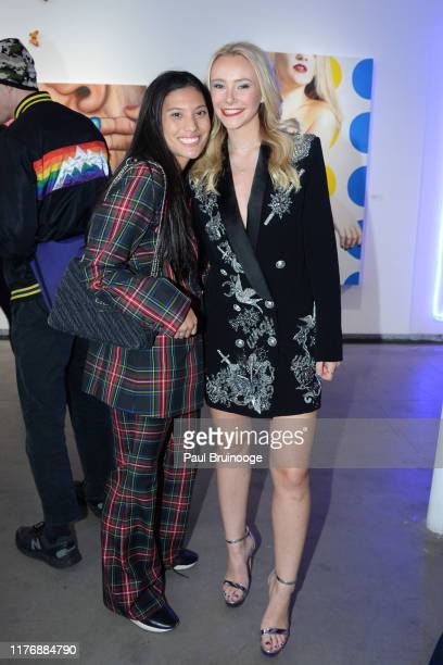 Taylor Irizarry and Alexandra Houx Grounds attend Delusions of the Wild Solo Exhibition By Alexandra Houx Grounds at 213 Bowery on October 17 2019 in...