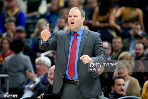 Taylor Jenkins the head coach of the Memphis Grizzlies gives instructions to his team against the Indiana Pacers at Bankers Life Fieldhouse on...