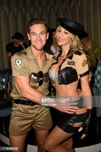 Taylor John Smith and Jamie Villamor attend Podwall Entertainment's 10th Annual Halloween Party presented by Maker's Mark on October 31 2019 in West...