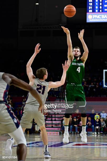 Taylor Johnson of the Dartmouth Big Green shoots the ball against Ryan Betley of the Pennsylvania Quakers during the first half at The Palestra on...