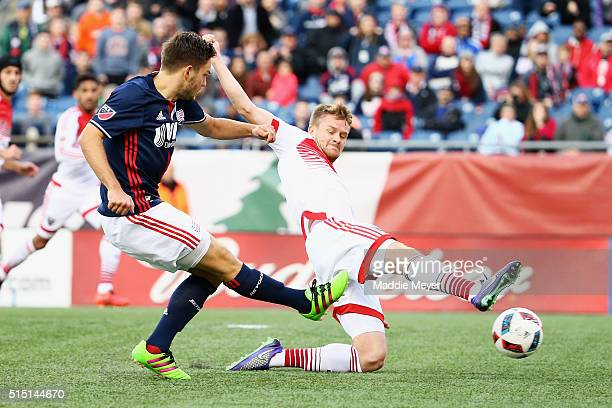 Taylor Kemp of DC United defends a shot by Kelyn Rowe of New England Revolution during the second half at Gillette Stadium on March 12 2016 in...