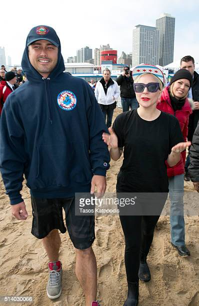 Taylor Kinney and Lady Gaga take part in the 16th Annual Polar Plunge at North Avenue Beach on March 6 2016 in Chicago Illinois