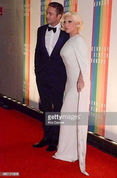 Taylor Kinney and Lady Gaga walk the red carpet during the 37th Annual Kennedy Center Honors at John F Kennedy Center for the Performing Arts on...