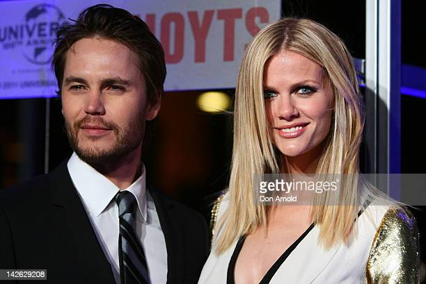 Taylor Kitsch and Brooklyn Decker arrive at the Battleship Australian premiere at Luna Park on April 10 2012 in Sydney Australia