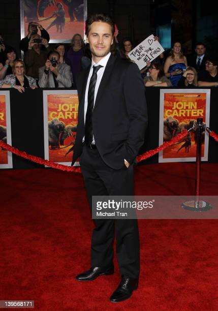 """Taylor Kitsch arrives at the world premiere of Disney's """"John Carter"""" held at Regal Cinemas L.A. Live on February 22, 2012 in Los Angeles, California."""