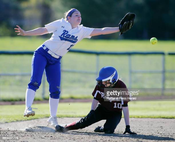 Taylor LaFlamme of Greely slide safely into third base as Allie Gregoire of Kennebunk can't reach the throw in the fourth inning