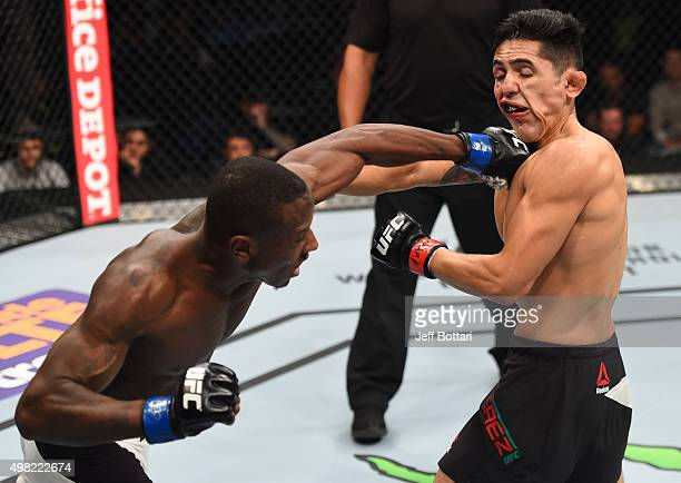 Taylor Lapilus of France punches Erik Perez of Mexico in their bantamweight bout during the UFC Fight Night event at Arena Monterrey on November 21...