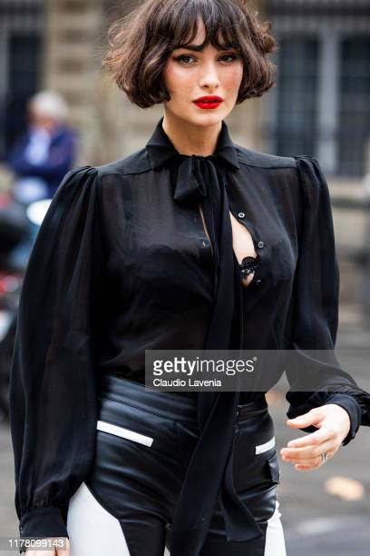 Taylor Lashae wearing a black blouse and black and white leather pants is seen outside the Redemption show during Paris Fashion Week Womenswear...