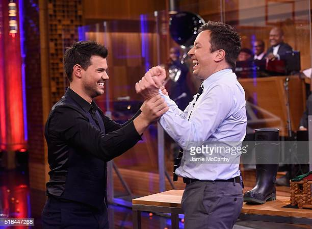 Taylor Lautner and host Jimmy Fallon during a segment on 'The Tonight Show Starring Jimmy Fallon' at NBC Studios on March 31 2016 in New York City
