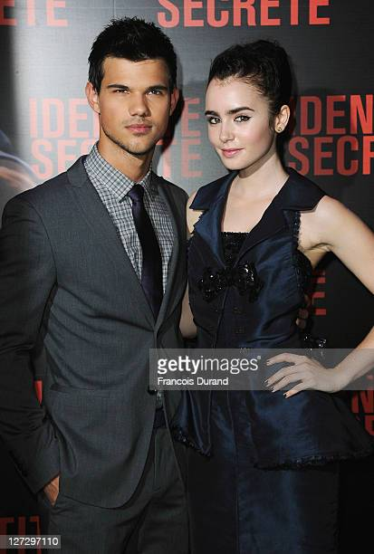 Taylor Lautner and Lily Collins attend the 'Secret Identity' Paris Premiere at Cinema Gaumont Marignan on September 27 2011 in Paris France