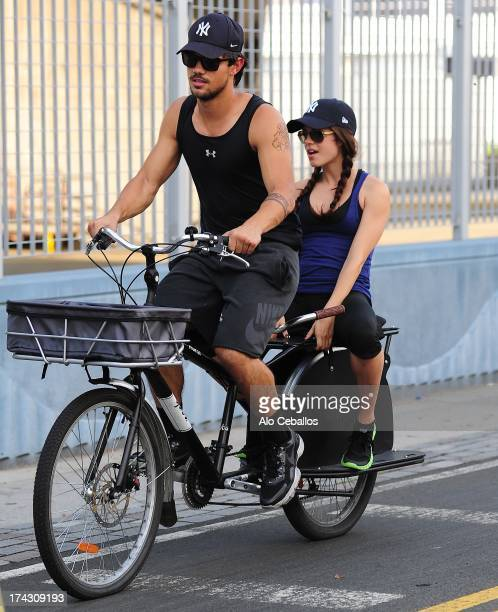 Taylor Lautner and Marie Avgeropoulos are seen in the West Side Highway on July 23 2013 in New York City