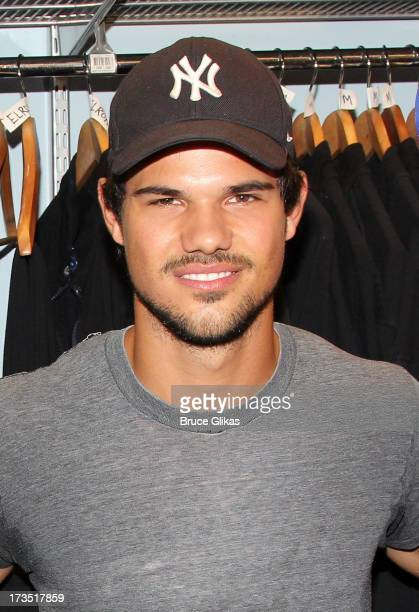 Taylor Lautner poses backstage at the hit show Blue Man Group OffBroadway at The Astor Place Theater on July 15 2013 in New York City