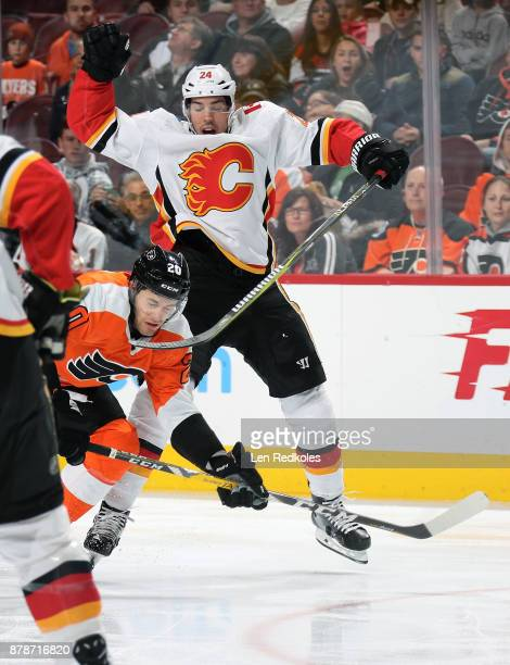 Taylor Leier of the Philadelphia Flyers collides with Travis Hamonic of the Calgary Flames on November 18 2017 at the Wells Fargo Center in...