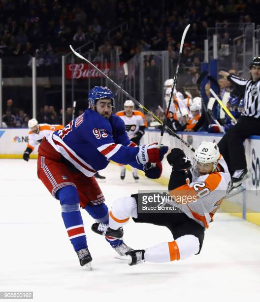 Taylor Leier of the Philadelphia Flyers is checked by Mika Zibanejad of the New York Rangers during the third period at Madison Square Garden on...