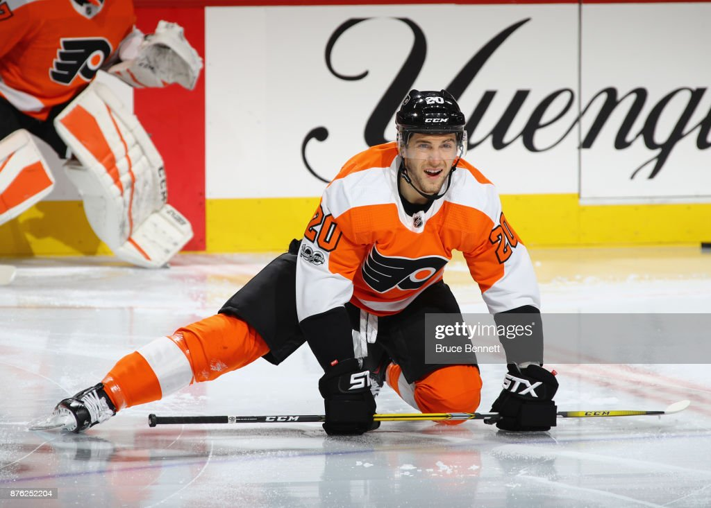Taylor Leier #20 of the Philadelphia Flyers stretches during warmups prior to the game against the Calgary Flames at the Wells Fargo Center on November 18, 2017 in Philadelphia, Pennsylvania. The Flames defeated the Flyers 5-4 in overtime.