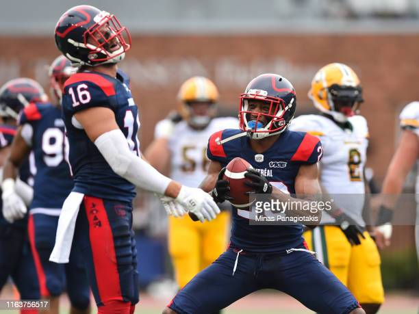 Taylor Loffler and teammate Tommie Campbell of the Montreal Alouettes react against the Edmonton Eskimos during the CFL game at Percival Molson...
