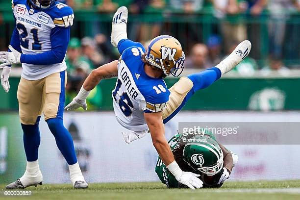 Taylor Loffler of the Winnipeg Blue Bombers goes flying over Naaman Roosevelt of the Saskatchewan Roughriders after making a tackle in the game...