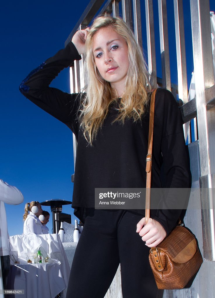 Taylor Marie, actress from Los Angeles, wearing Foreign Exchance blouse, and vintage purse on January 20, 2013 on the streets of Park City, Utah.