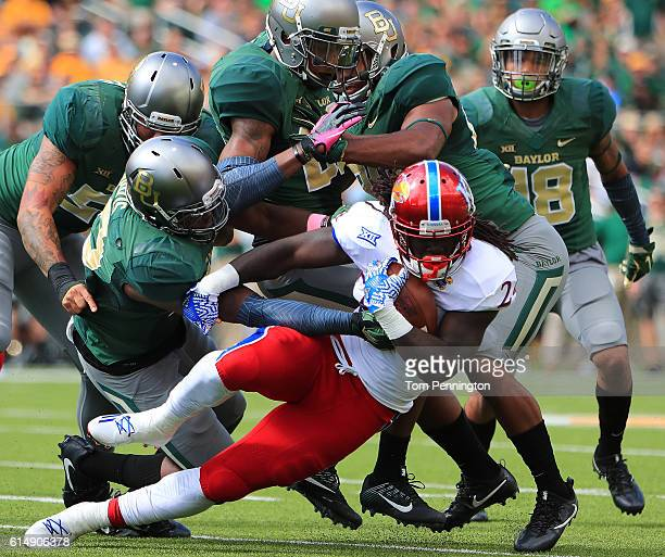 Taylor Martin of the Kansas Jayhawks is stopped for a loss against the Baylor Bears defense in the first half on October 15 2016 in Waco Texas