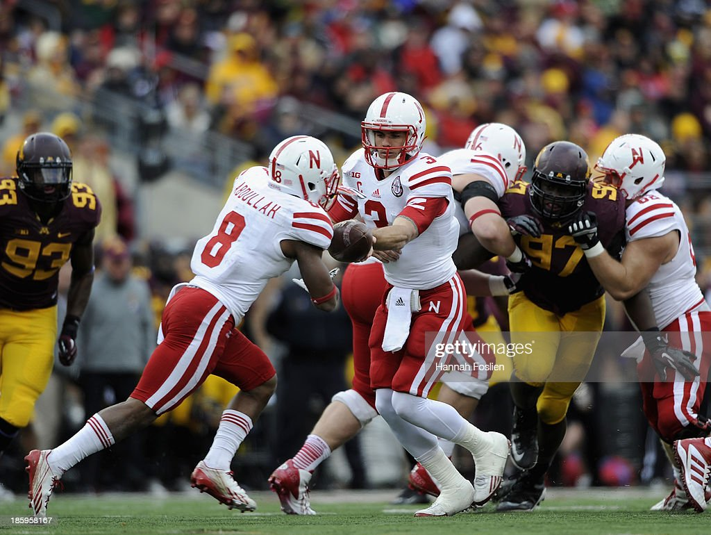 Taylor Martinez #3 of the Nebraska Cornhuskers hands the ball to Ameer Abdullah #8 of the Nebraska Cornhuskers during the third quarter of the game against the Minnesota Golden Gophers on October 26, 2013 at TCF Bank Stadium in Minneapolis, Minnesota. The Golden Gophers defeated the Cornhuskers 34-23.