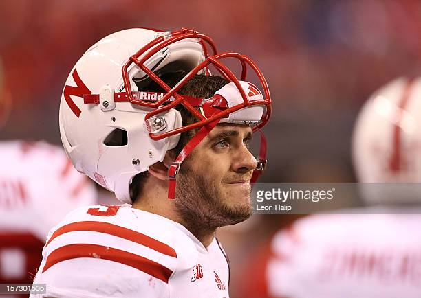 Taylor Martinez of the Nebraska Cornhuskers wacthes the action on the sidelines during the third quarter of the Big Ten Championship game against the...