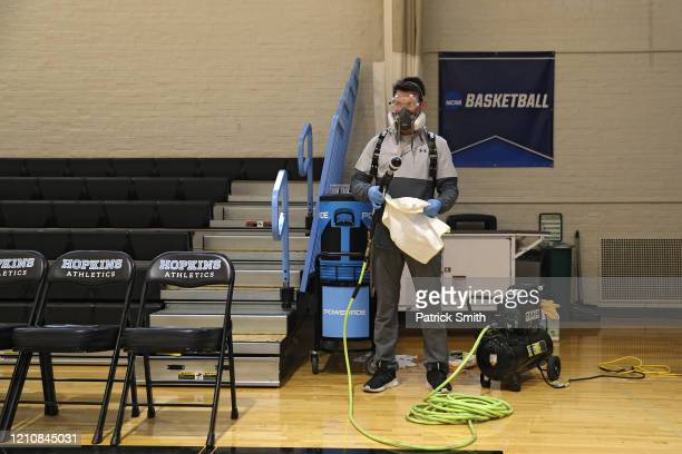 Taylor Michel Director of Operations of DTG Disinfecting Technologies Group prepares to disinfect the arena following Yeshiva playing Worcester...