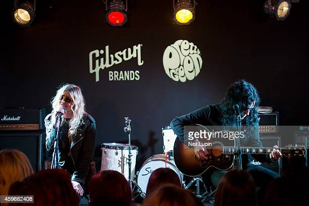Taylor Momsen and Ben Phillips of the Pretty Reckless performs an acoustic set for competition winners at the Gibson Guitar Lounge on November 27...