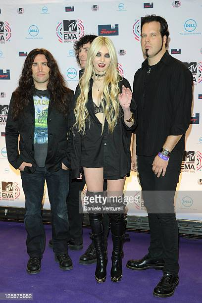 Taylor Momsen and The Pretty Reckless pose in front of the media boards at the MTV Europe Music Awards 2010 on November 7, 2010 in Madrid, Spain.